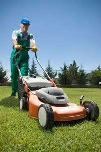 How to start a lawn care business. Lawn mowing business owner cutting grass.